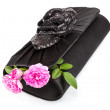 Black handbag with roses — Stock Photo