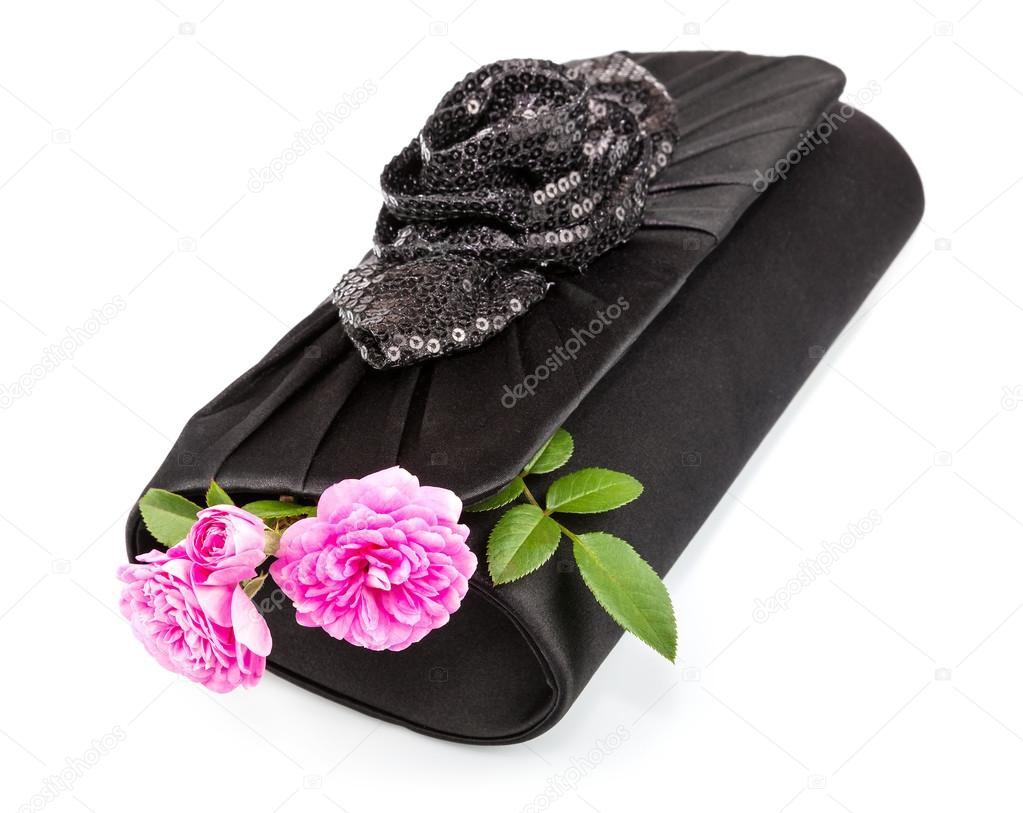 Black handbag with roses inside isolated on white background  Stock Photo #18242845
