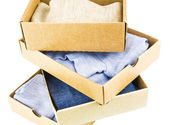 Stack of cartons with clothes — Stock Photo