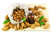 Almonds in the sack and almond oil — Stock Photo