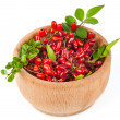 Branches of barberries in wooden bowl - Stock Photo