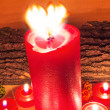 Lighted red candles — Stock Photo