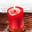 Composition from red candle and water - Stock Photo