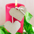 Royalty-Free Stock Photo: Two paper hearts and lighted red candle