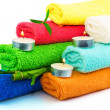 Towels with candles and bamboo — Stock Photo