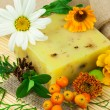 Composition from natural soap, berries and flowers - Stock Photo