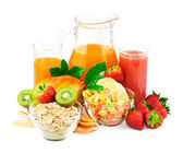 Breakfast ingredients with juice and fresh fruit — Stock Photo