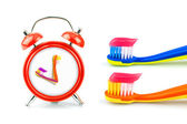 Composition from clock, toothbrushes with toothpaste — Stock Photo