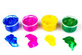 Color paint cans and dabs of paint — Stock Photo