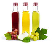 Three glass bottles of vinegar — Stock Photo