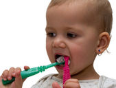 Girl with toothbrushes — Stock Photo