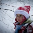 Boy in winter forest — Stock Photo