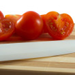 Stock Photo: Knife and tomatoes