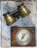 Binocular and compass — Stock Photo