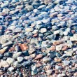 Stock Photo: Varicolored stones under water