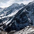 Severe mountains covered with snow — Stock Photo