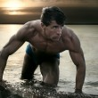Muscular man posing in water — Stock Photo