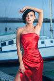 Woman in glossy red dress — Stock Photo
