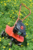 Tractor plough from front side on the flowering field — Stock Photo