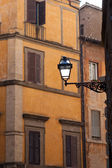 Facades old medieval stone with street lamp in city Rome Italy — Stock Photo
