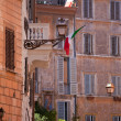 Picturesque facades of old urban residential houses in Rome Ital - Stock Photo