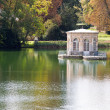 Wonderful Renascence style summerhouse on tranquil lake in autum — Stock Photo