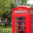 London symbol red phone box residential district background — Stock Photo