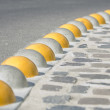 Stock Photo: Curb separated asphalt road and cobblestone