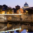 Saint Peter's Basilica Rome Italy on Tiber bank in evening - Stock Photo