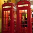London symbol two red phone boxes at illuminated street — Stock Photo #15340339