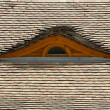 Attic window on the tilled roof — Stock Photo