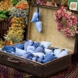 Dried wild flowers and handmade decor in old fashioned suitcase - Foto de Stock