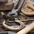 Blacksmith tools and horseshoes close-up — Stock Photo #15340561