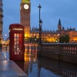 London symbols: telephone box, clock Big Ben Tower in twilight — Stock Photo #15340581