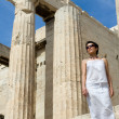 Woman near Propylaea Columns Acropolis Athens Greece on sky back — Stock Photo #15341269