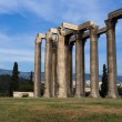 Ancient Temple of Olympian Zeus in Athens Greece on blue sky bac — Stock Photo