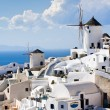 Traditional windmills in village Oia of Cyclades island Santorin — Stock Photo