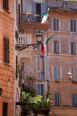 Picturesque facades of old urban residential houses in Rome Ital — Stock Photo