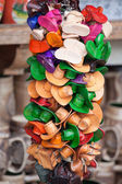 Souvenirs multicolored handmade leather hats and boots on craft — Stock Photo