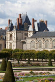 Medieval royal castle Fontainbleau near Paris in France and gard — Stock Photo