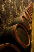 Row of Wine barrels in winery cellar recedes into the distance — Stock Photo