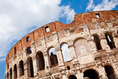 Arched facade of ancient landmark amphitheatre Colosseum in Rome — Stock Photo