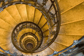 Spiral staircase and stone steps in ancient tower — Stock Photo