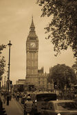 London street: traffic jam and clock Big Ben Retro style with gr — Stock Photo