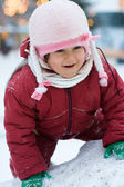 Little happy child on the top of snow hill — Stock Photo