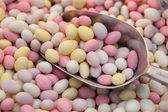 Multicolored candy sweet drops on metal scoop close-up in store — Stock Photo