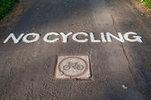 Traffic sign no cycling on park asphalt pathway — Stock Photo