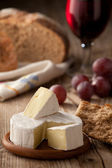 Traditional Normandy Camembert cheese with homemade bread, glass — Stock Photo