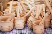 Handmade wooden pounder, pestle at street handicraft market — Stock Photo