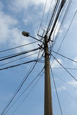 Lamp pole and tangled electric wires — Stock Photo